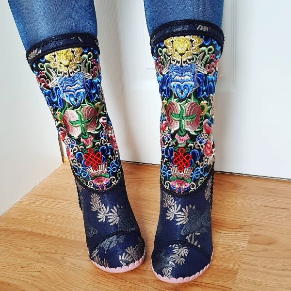 wearing embroidered navy knee high boots with fish jacquard print