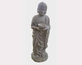 Patung Buddha berdiri membawa Tempat Lilin