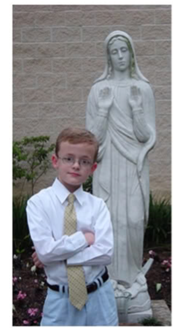 First Communion boy with Mary Statue