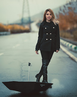 woman in black double button jacket 2887766