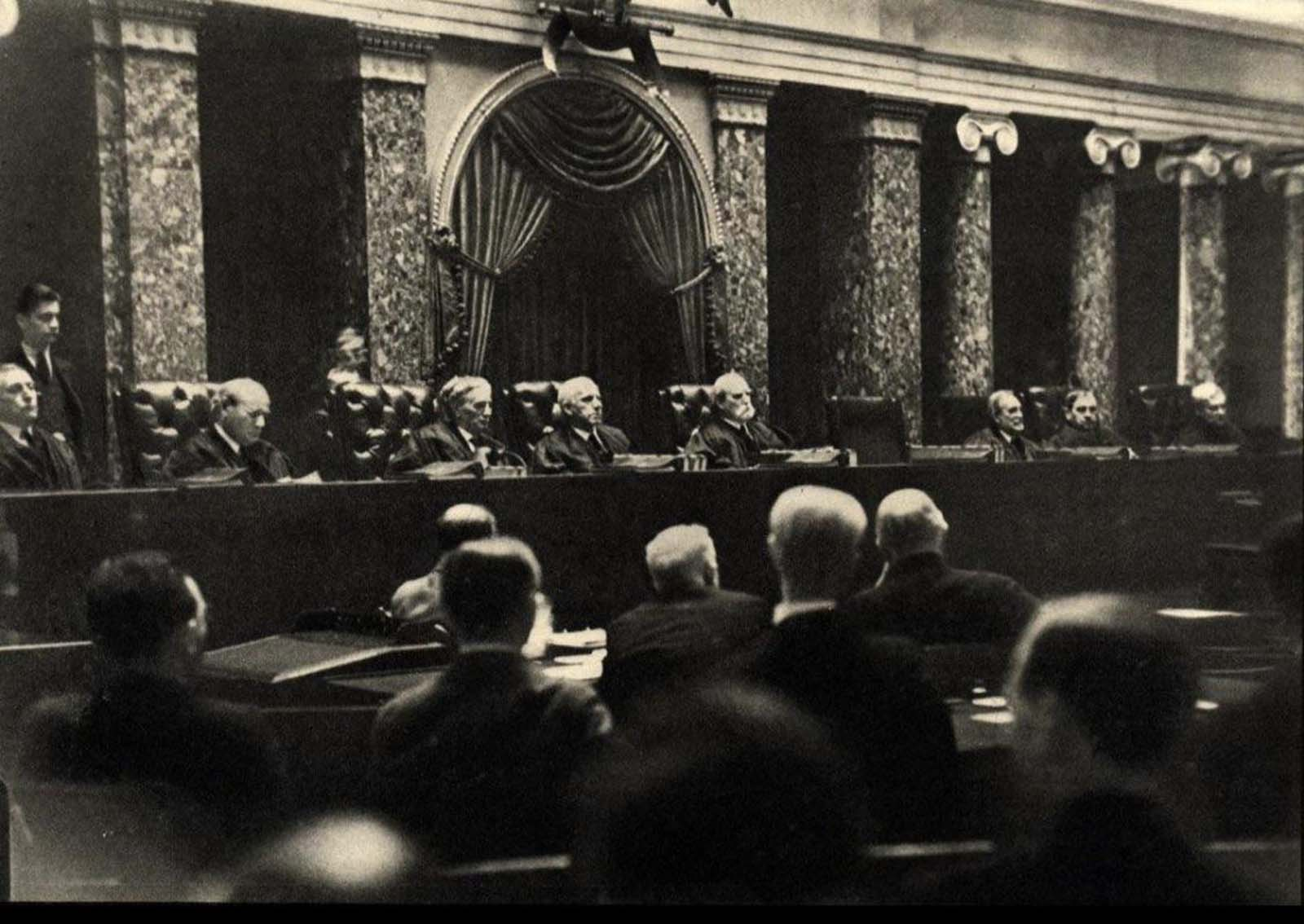 Illegal picture taken inside the US Supreme Court in 1932. Dr. Erich Salomon faked a broken arm so he could hide a camera in his cast.