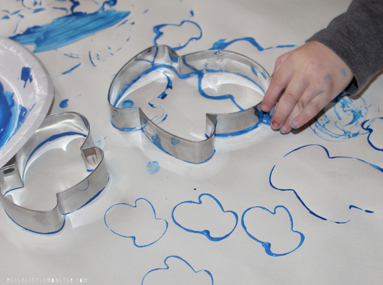 cookie cutter painting winter activity for toddlers and preschoolers