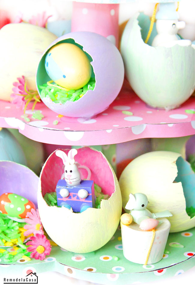 small rabbits, flowers, birds and egg shells for Easter egg tree.