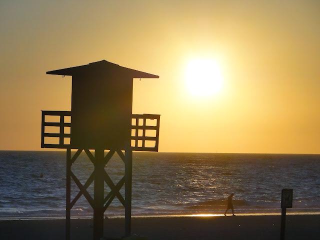 Puesta de sol en la Playa de la Victoria