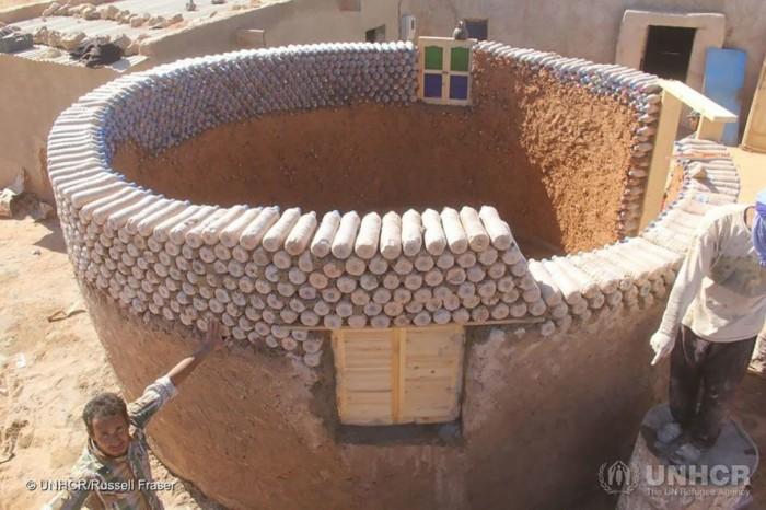 The guy builds houses using sand bottles instead of bricks