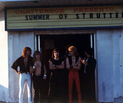 Strutter in front of the Chatterbox rock club