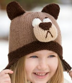 http://www.redheart.com/free-patterns/bashful-bear-hat