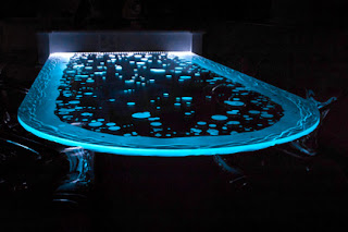 A Carved Glass Table With Build-In Lights