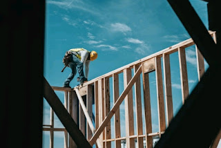 a man working on a wooden beam