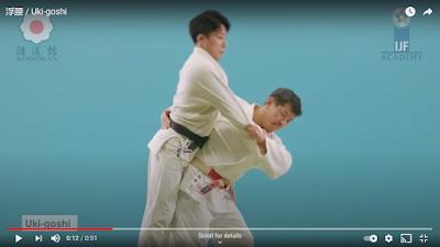 Picture of Tori pulling Uke's sleeve during the judo throw of Uki Goshi