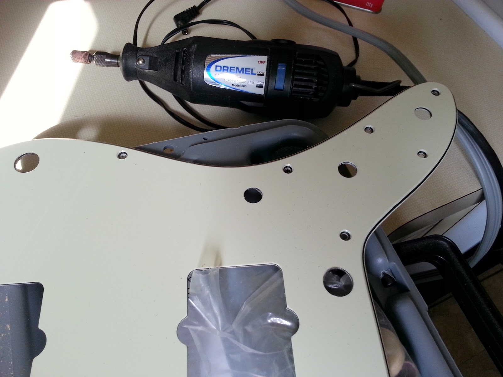 because the new pots are so much thicker you do need to widen the holes in the pickguard for them dremel to the rescue i found that its smallest sanding  [ 1600 x 1200 Pixel ]