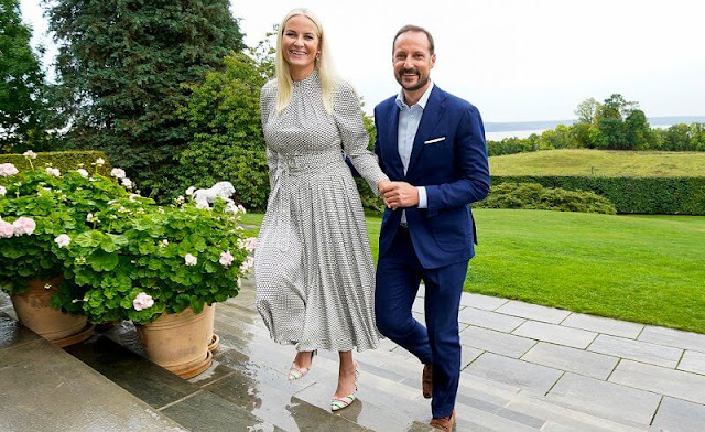 Crown Princess Mette-Marit wore a high neck belted polka-dot silk midi dress by Diane von Furstenberg. Malone Souliers Brenda stripe pumps
