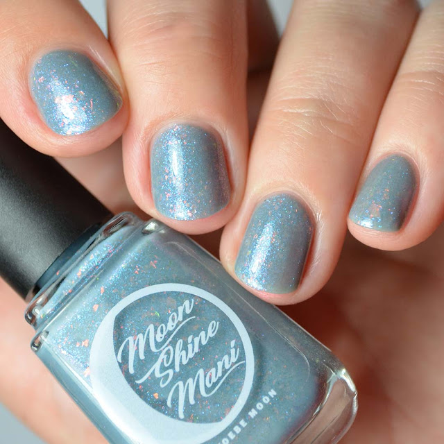 blue grey nail polish with color shifting shimmer and flakies