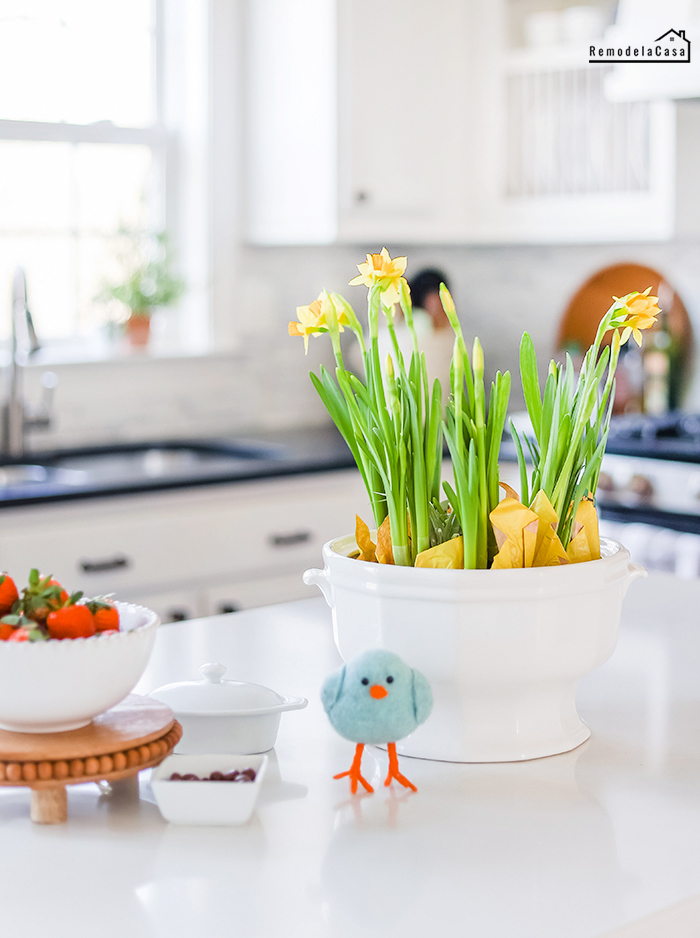 Daffodils on kitchen island with felt blue bird