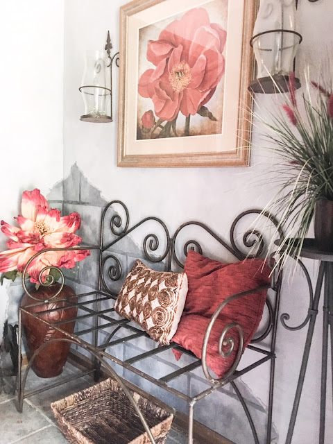 entryway metal bench with red pillows