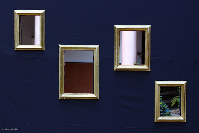 A Minimalist Photograph of Hollow Photo Frames on a Blue Tent at St Xaviers College during a Photography Competition cum Exhibition.