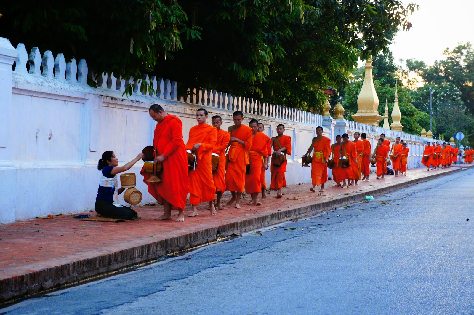 Luang Prabang - Monks receiving offerings from locals