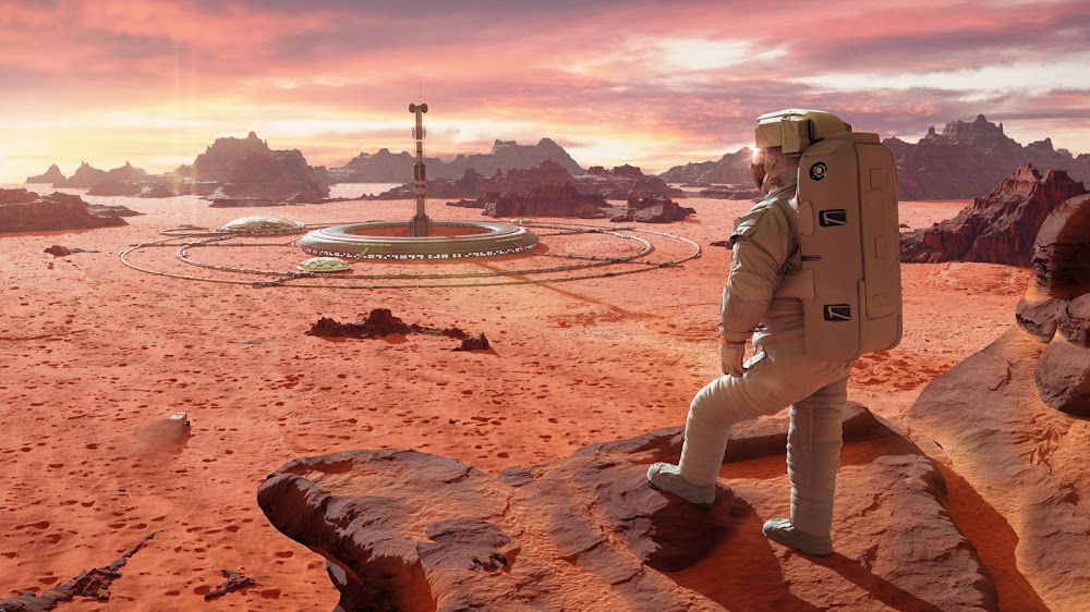 Astronaut looking at Martian colony by Dotted Yeti