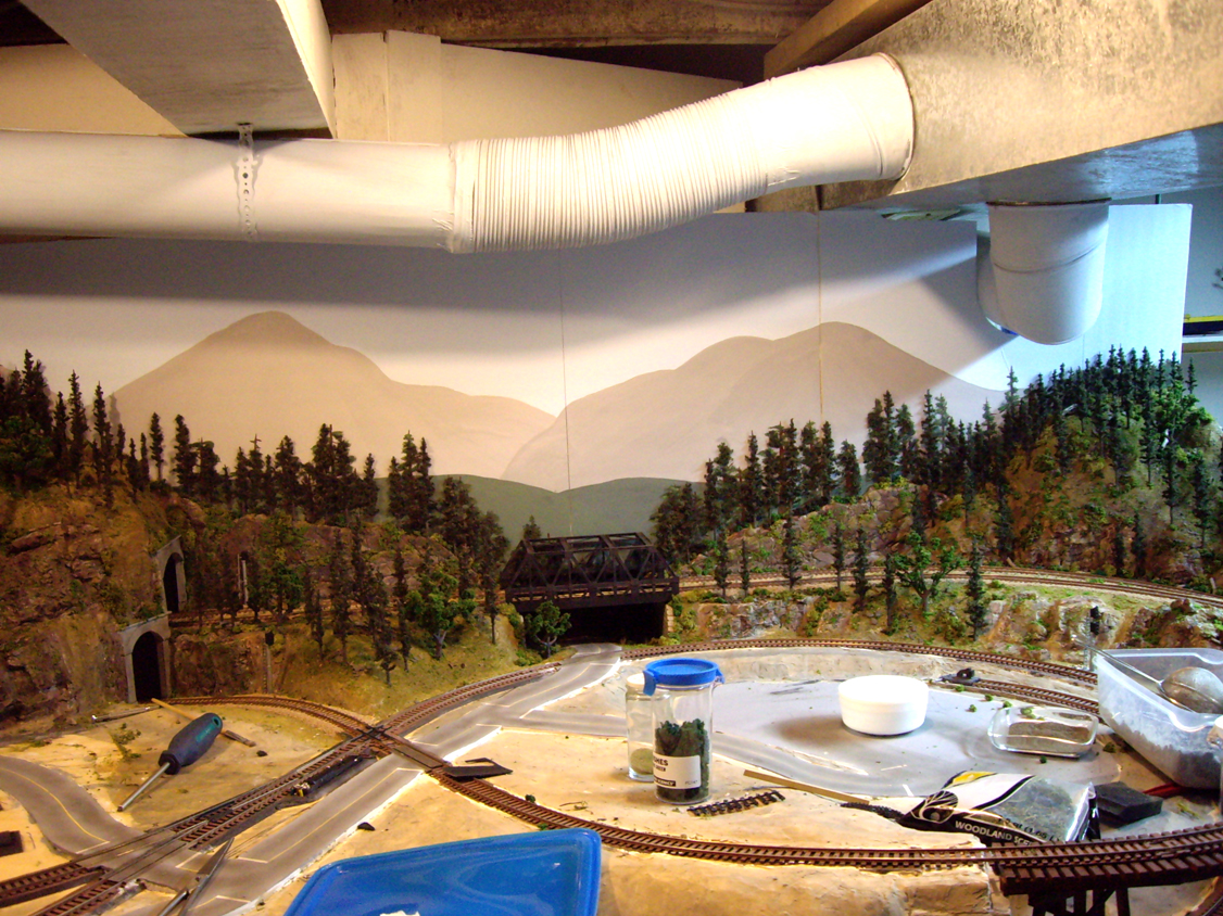 Completed background mountain forest scenery consisting of ground foam, trees, talus and field grass
