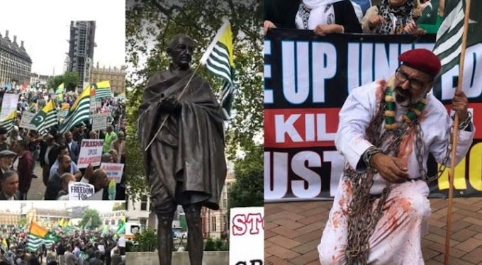 The protesters hoisted the Kashmir flag on Gandhi's statue