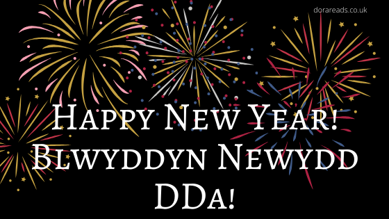 'Happy New Year! Blwyddyn Newydd DDa!' with black background and fireworks