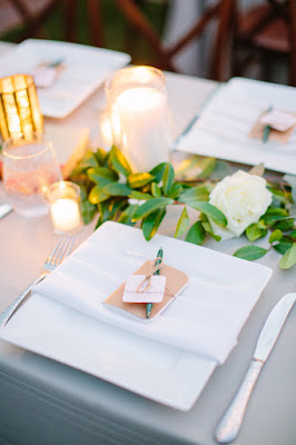clean white with foliage place setting