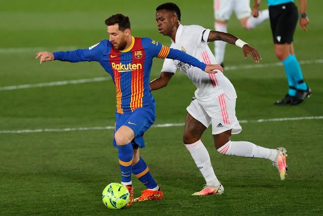 Barcelona forward Lionel Messi and Real Madrid forward Vinicius Jnr. during El Clasico match in La Liga