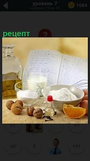 На столе лежат ингредиенты для приготовления и рецепт в тетради
