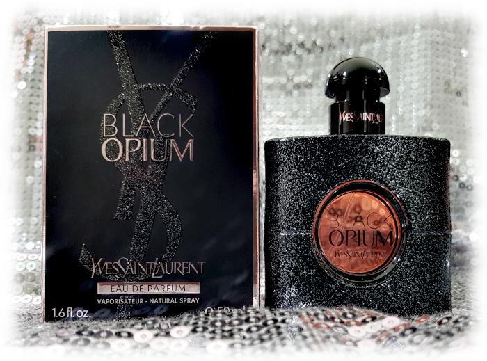 Black Opium bottle & box on silver sequinned background