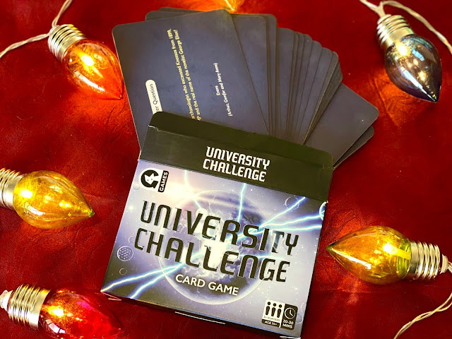 University Challenge Card Game in it's box with cards visible on a red background with Christmas lights