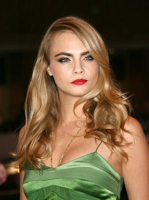 Cara Delevingne lit up the red carpet in her textured green dress