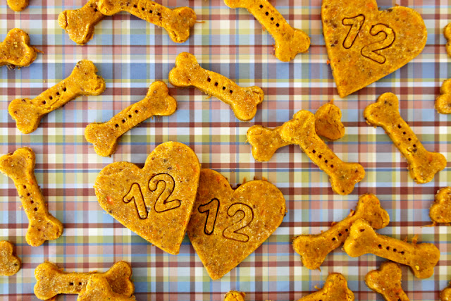 Dog treats shaped like bones and hearts stamped with the number 12