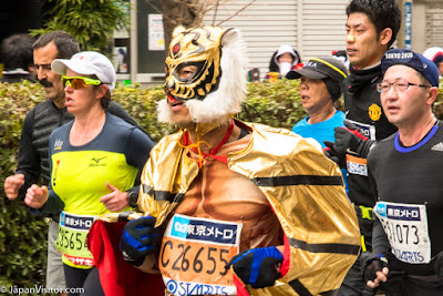 Costumed runners at the Tokyo Marathon 2018, Asakusabashi, Tokyo, Japan.