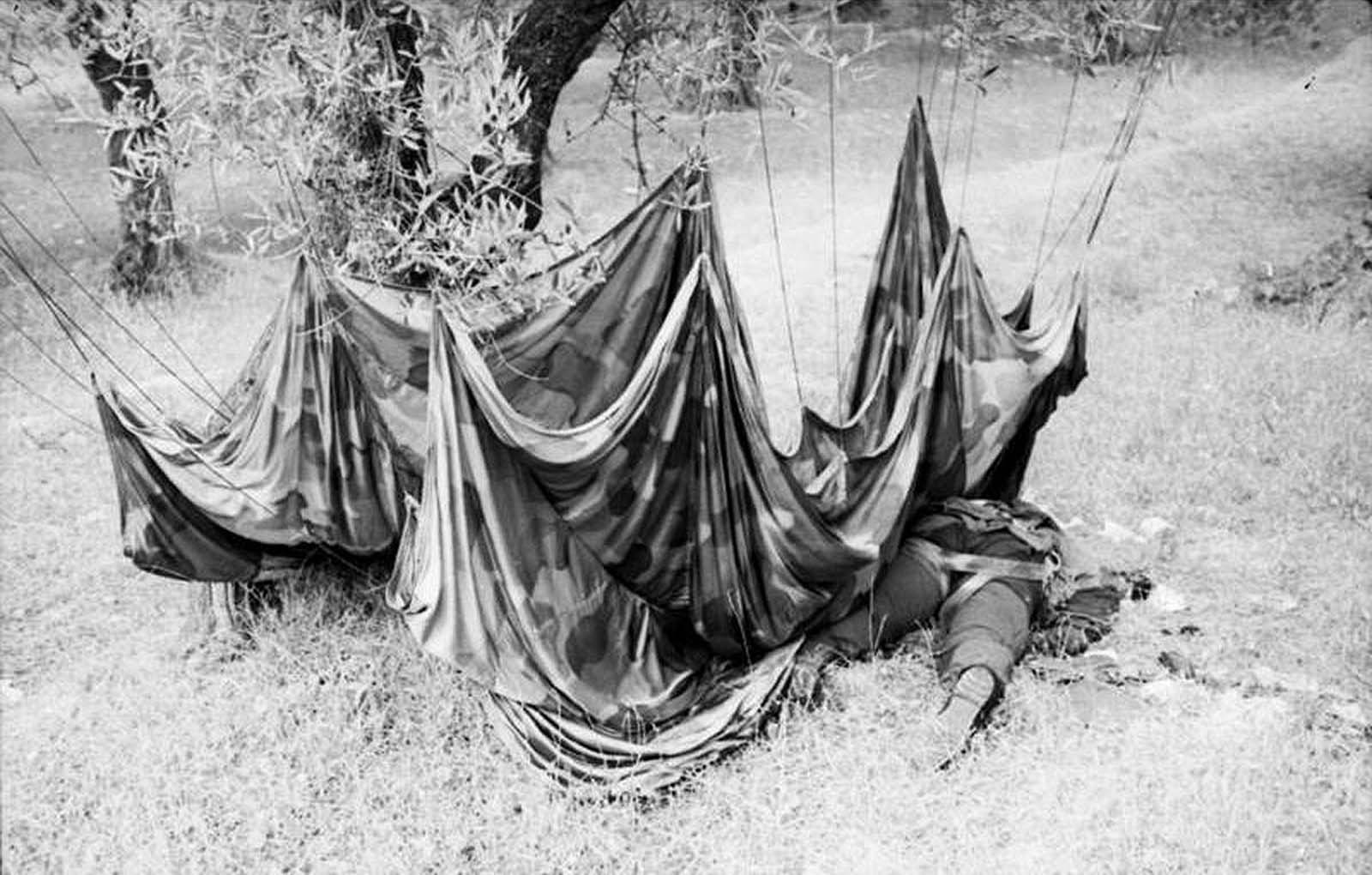 A fallen paratrooper and his parachute, on the island of Crete, in early 1941.