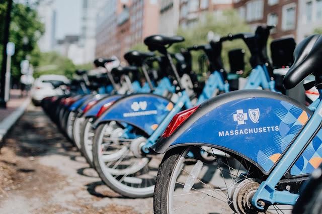bikes in bike share rack Photo by Kelly Sikkema on Unsplash