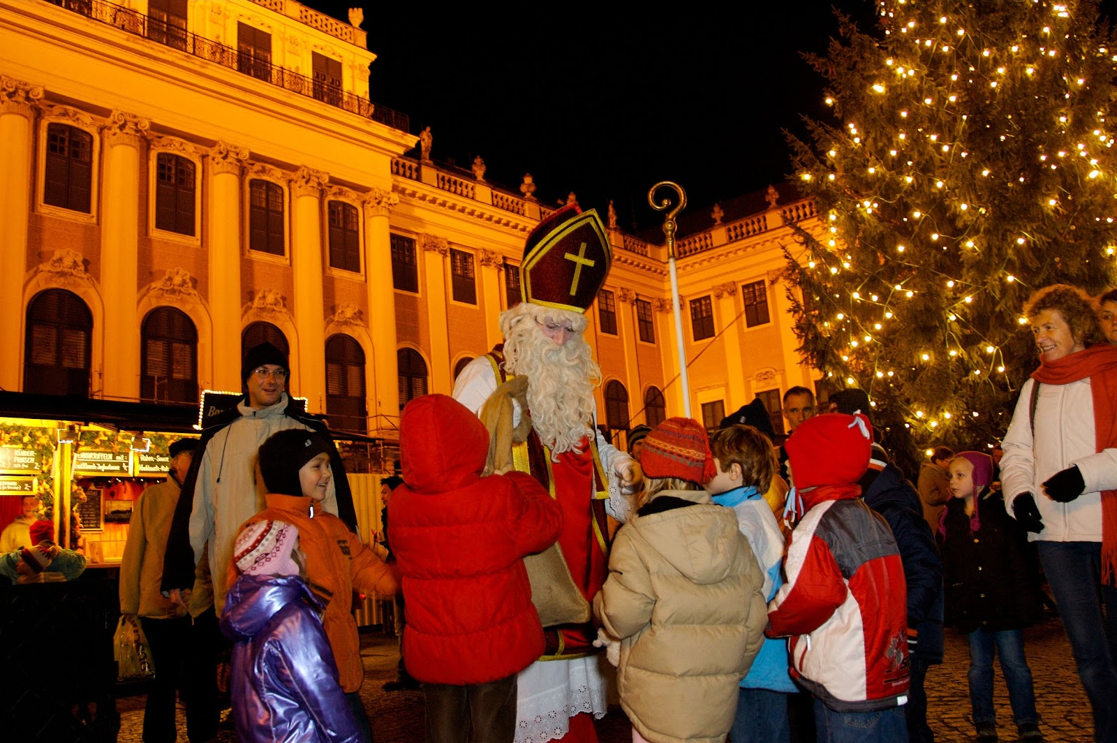 Saint Nicholas or Sinterklaas makes an appearance at the Schönbrunn Palace Christmas Market. Photo: Courtesy of Austria Tourism-©Gerhard Fally. Unauthorized use is prohibited.