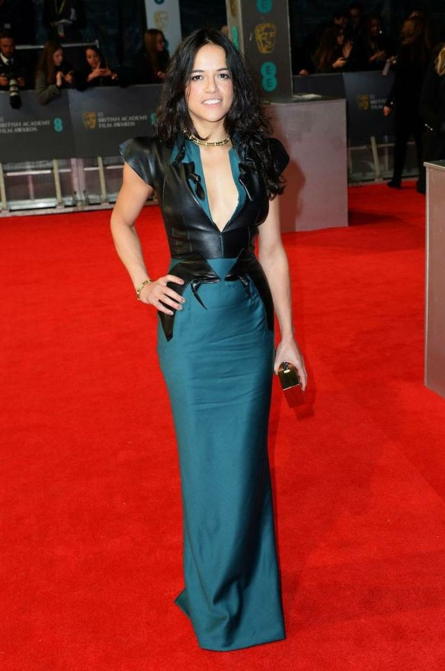 Michelle Rodriguez in a teal and leather detailed gown at the BAFTA 2014