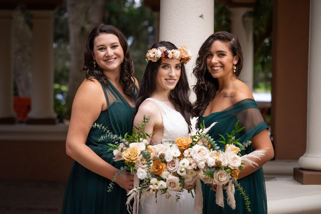 bride and bridesmaids in teal with big bouquets