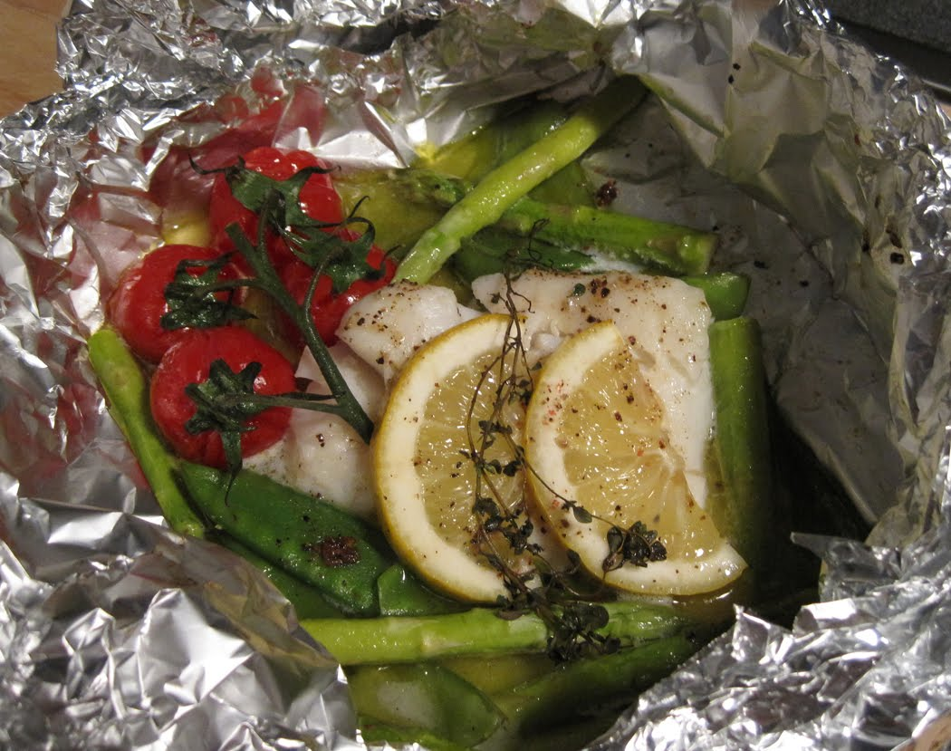 Cod en Papillote with Asparagus Mange Tout and Vine Tomatoes