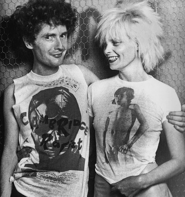 Malcolm McLauren & Vivienne Westwood 1976 wearing some X-rated explicit shirt of their creation.  PunkMetalRap.com