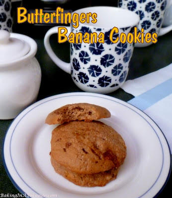 Butterfingers Banana Cookies are a soft cookie with a surprise crunch inside. Banana and crunchy peanut butter batter is studded with butterfingers pieces for a delicious flavor pairing. | Recipe developed by www.BakingInATornado.com | #recipe #cookies