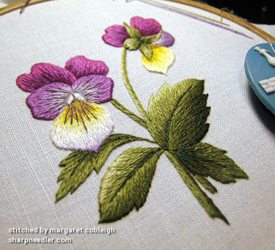 Completed thread painted violas. Photo taken at an agle showing the main leaf in 3-D
