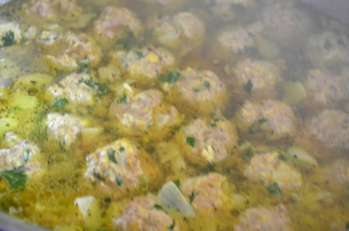 12 cups simmering Chicken Stock with Meatballs added.