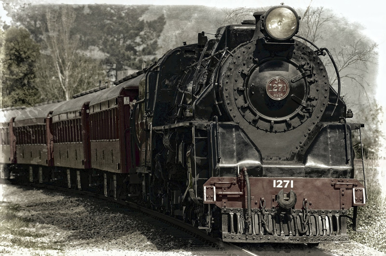 old-fashioned locomotive traveling forward on track to illustrate blog post about hitler's personal train