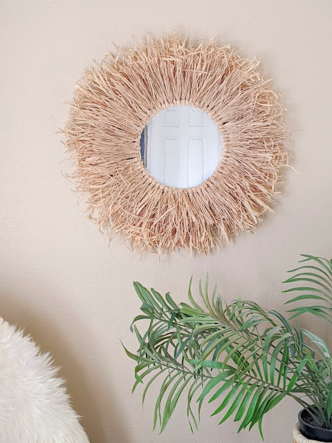 Make this Anthropologie/Urban Outfitters inspired DIY raffia mirror in an afternoon! No macrame or sewing skills required - just a glue gun and a mirror!