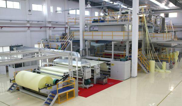Non woven fabric processing machine