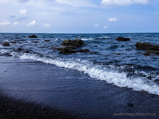 Exotic Rocky Beach Scenery And The Seawater Waves At Umeanyar Beach, North Bali, Indonesia