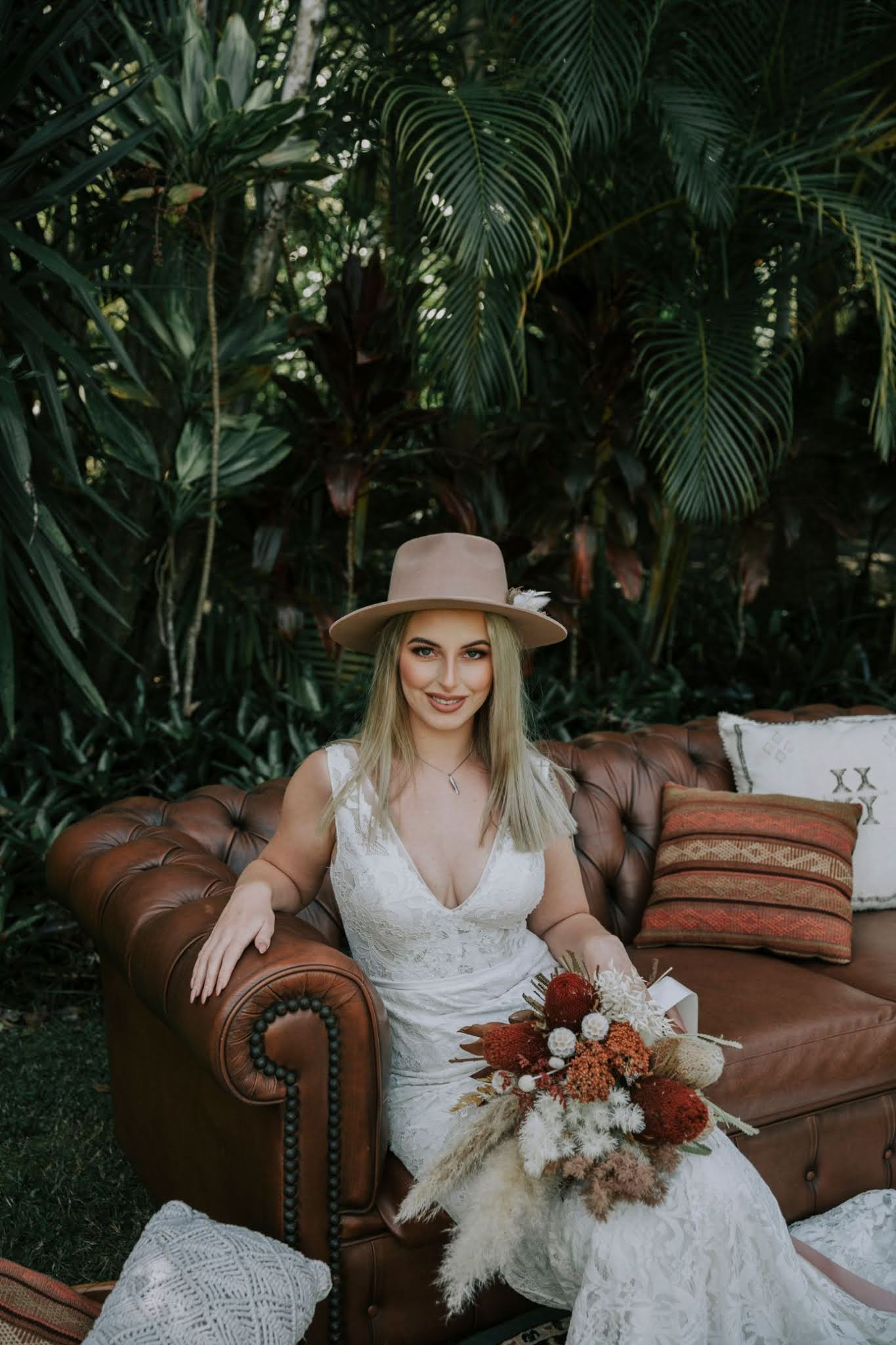 Atomic Butterfly Photography florals leather couch hat cake venue styling