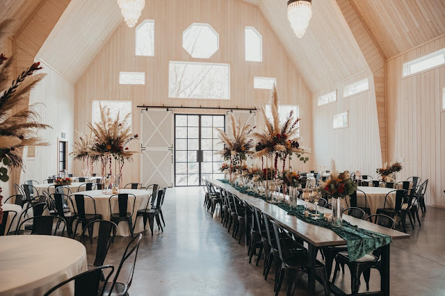 fall wedding reception with centerpieces at various heights