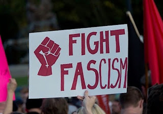 """Sign held at rally, with drawing of a fist and the words """"FIGHT FASCISM"""""""